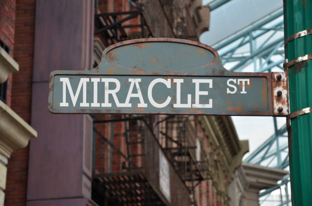 Street sign on the corner of Miracle Street stock photo
