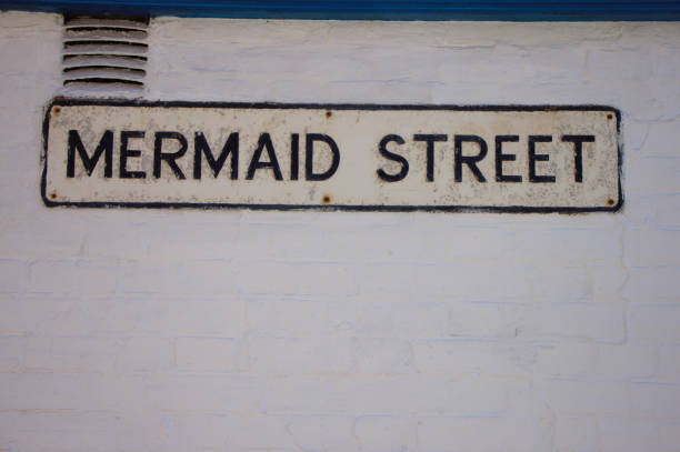 Street sign on white wall, Mermaid Street in Rye, UK stock photo