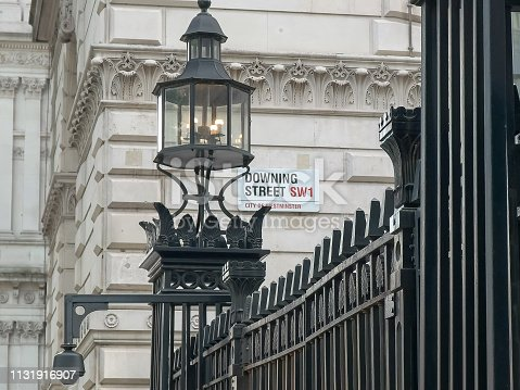 street sign outside downing street in london, home to the residence of the british prime minister