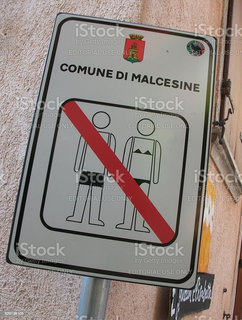 Street Sign Saying Barely Dressed Not Allowed stock photo