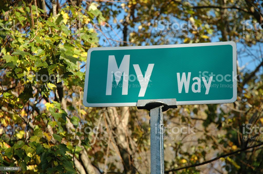 Street sign stating My way with trees in background stock photo