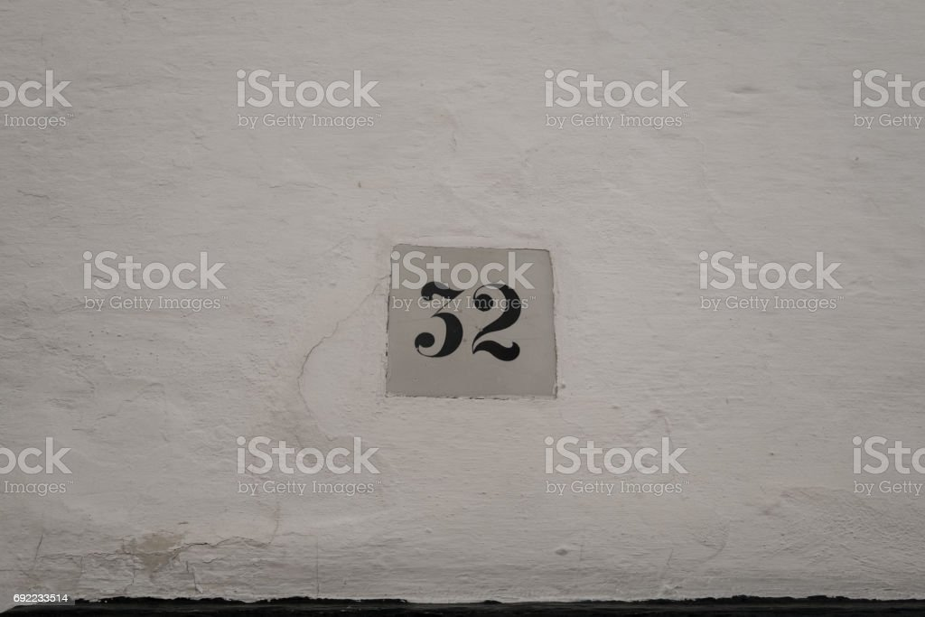 Street sign with the number 32 stock photo