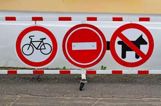 Street signs no cycling no entry no dogs picture id863583922?b=1&k=6&m=863583922&s=612x612&w=0&h=gmb0ynmlz ojexg3eyjieeqkextt9uscoww9jhqrfxo=