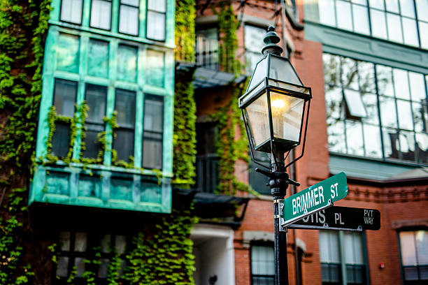 Street signs on a lamp post in Beacon Hill Boston stock photo