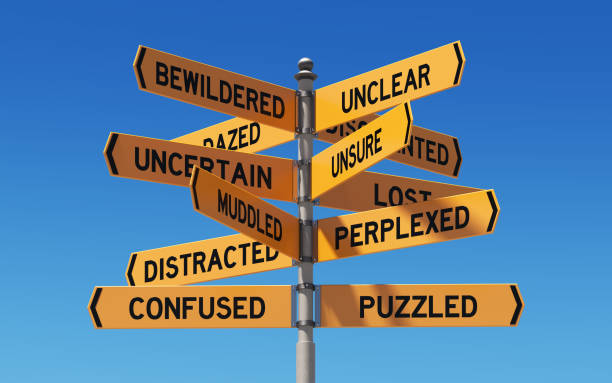 street signs pointing different directions - chaos stock pictures, royalty-free photos & images