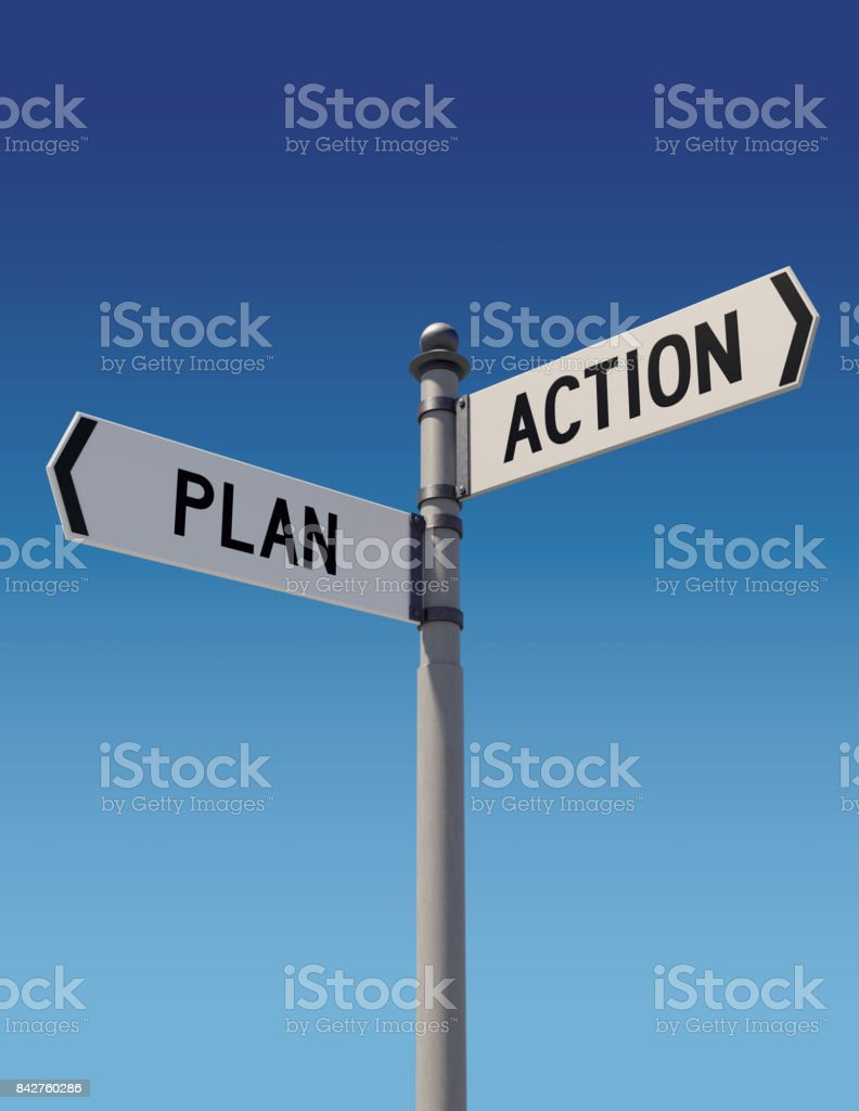 Street signs pointing opposite directions: Plan and Action stock photo