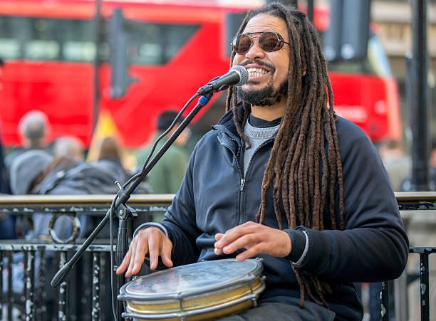 street singer with jembe. united kingdom - reggae stok fotoğraflar ve resimler