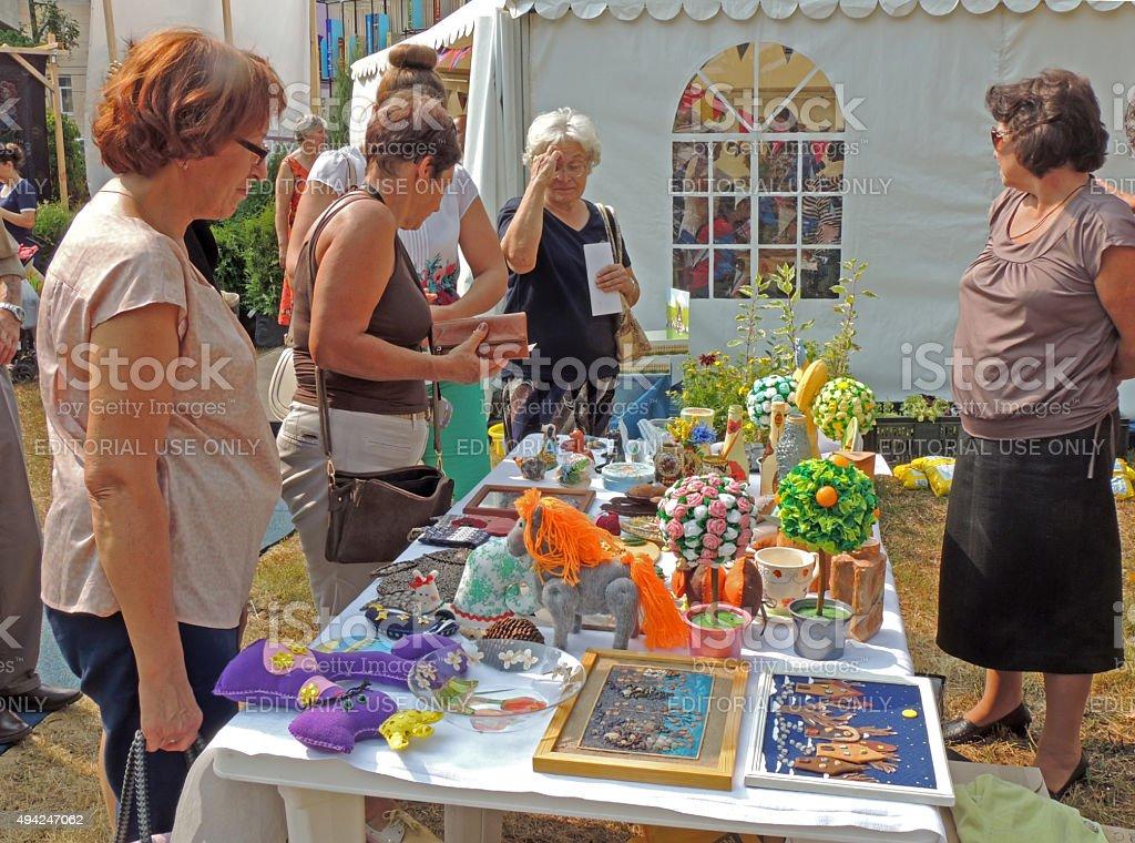 Street stand with handicraft knick-knacks stock photo