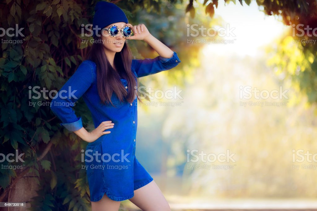 Street Style Fashion Girl Wearing a Blue Denim Romper stock photo