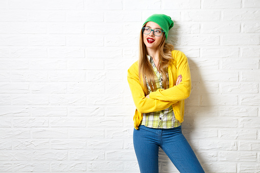 istock Street Style Hipster Girl at White Brick Wall Background 497792414