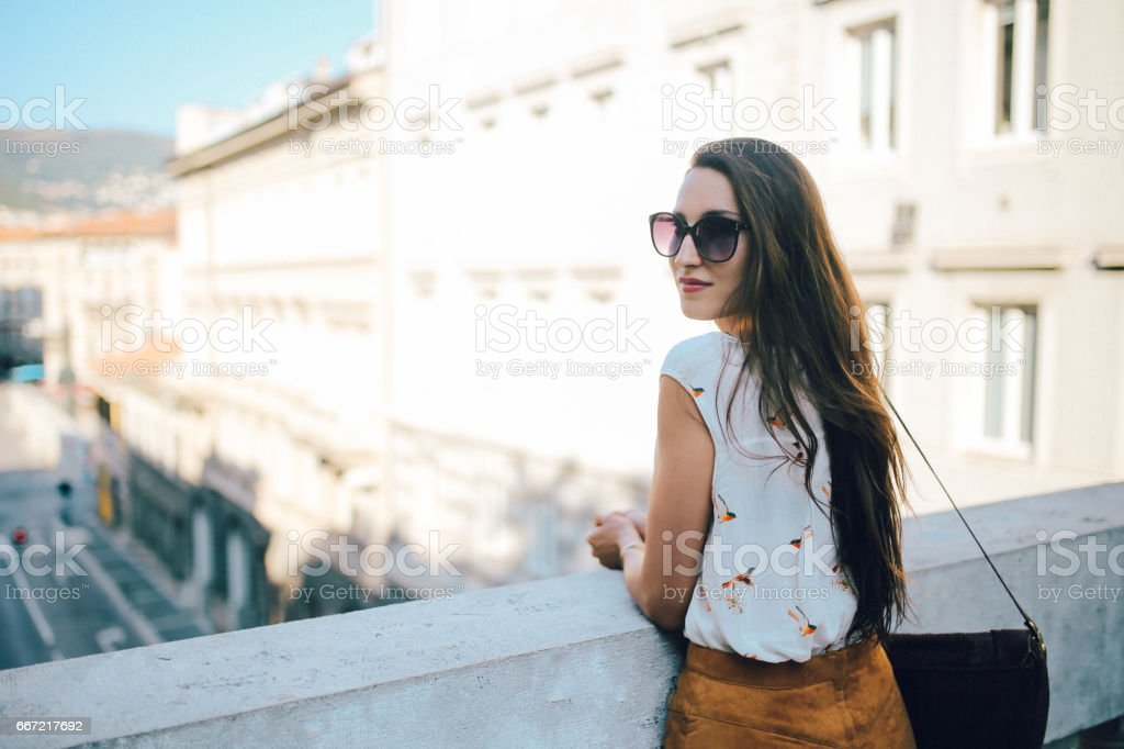 Street style portrait of a young brunette in Trieste, Italy royalty-free stock photo
