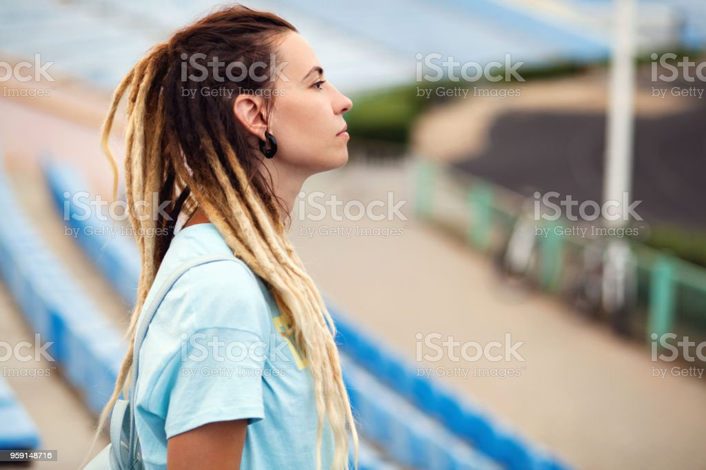 Street style portrait of beautiful stylish girl stock photo