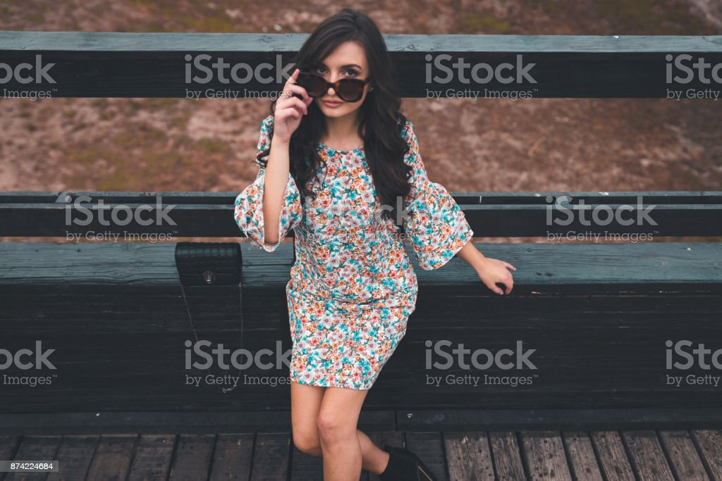Street styled woman enjoying beautiful day in the city stock photo