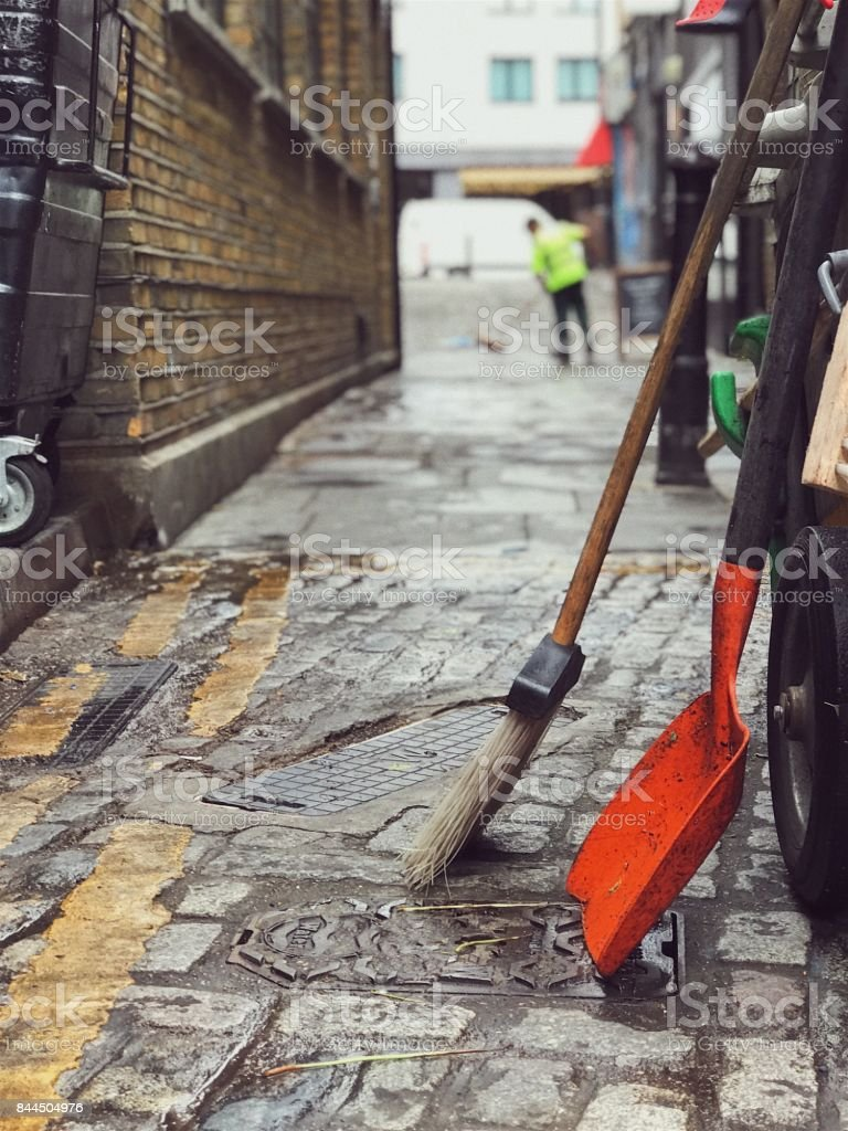 Street sweeper in London on a rainy day stock photo