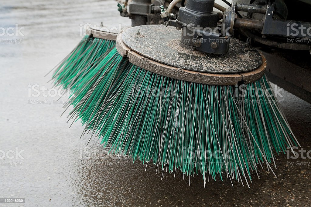 Street sweeper part of a street cleaning vehicle Asphalt Stock Photo