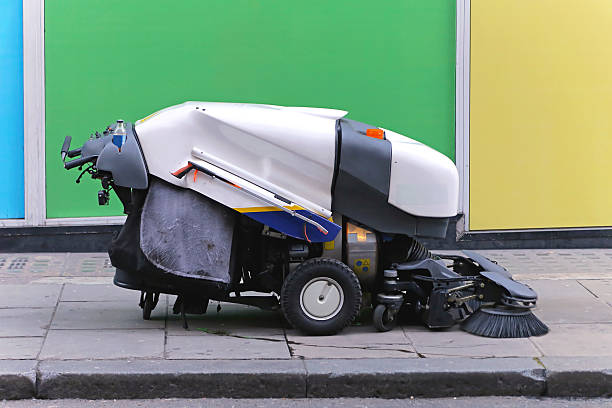 Street sweeper Side view of street sweeping cleaner vehicle street sweeper stock pictures, royalty-free photos & images