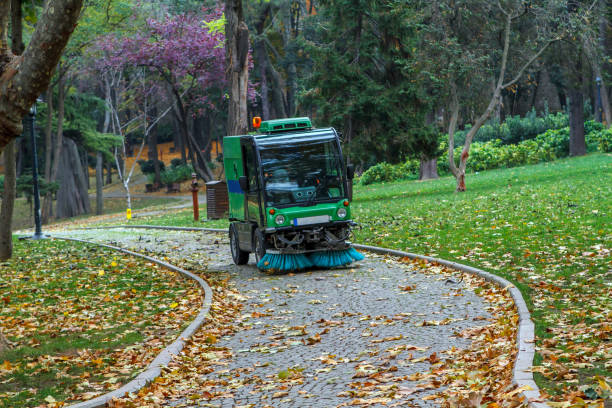 Street sweeper removing leaves Street sweeper removing leaves in Gulhane Public Park, Istanbul street sweeper stock pictures, royalty-free photos & images