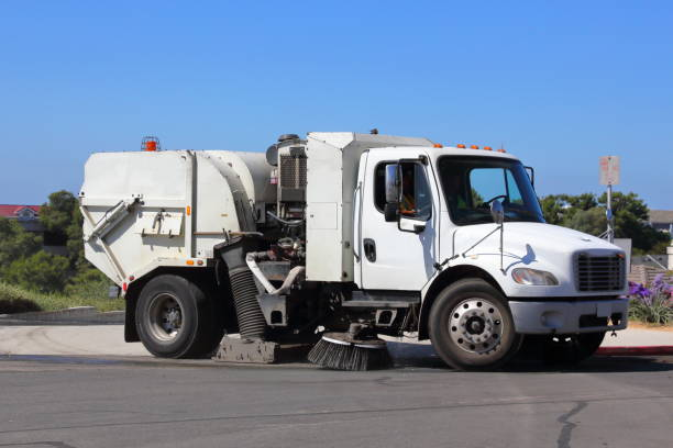 Street Sweeper, Sweeping the Street A city street sweeper, sweeping a street that drains into the ocean. street sweeper stock pictures, royalty-free photos & images