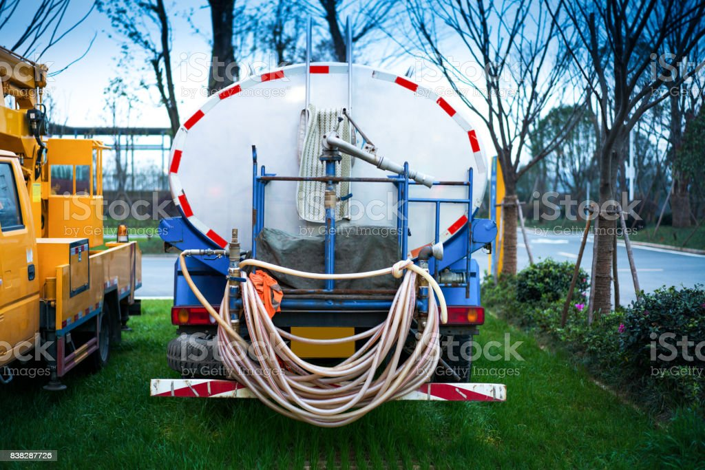 Street sweeper with the vacuum cleaner for cleaning of highways stock photo