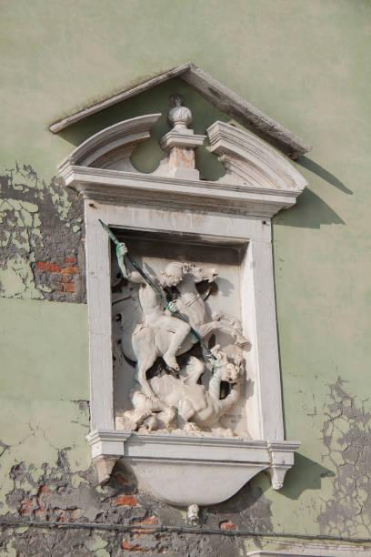 street tabernacle in venice. madonna - batalina italy стоковые фото и изображения