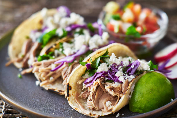 street tacos - with carnitas, red cabbage and queso fresco cheese - taco foto e immagini stock