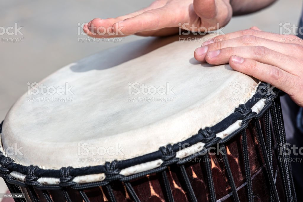 street talented musician playing african drum djembe outdoors stock photo