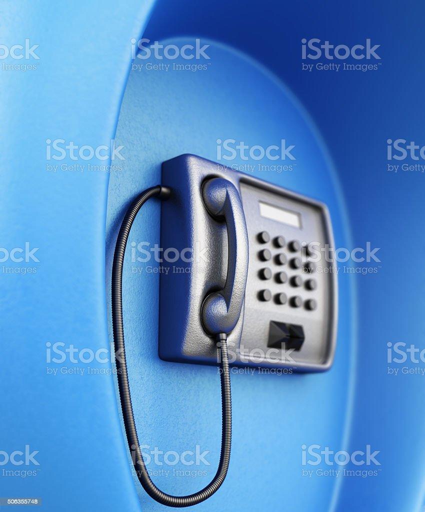 Street telephone closeup in blue box. stock photo