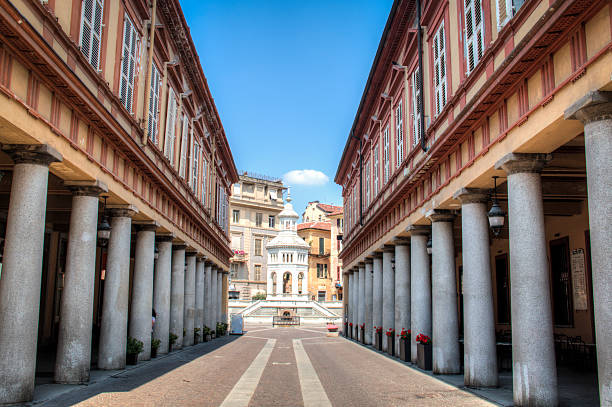 Street to fountain in Acqui Terme, Italy Street with historic columns leading to the main square in Acqui Terme in Italy artistical stock pictures, royalty-free photos & images