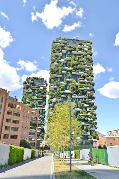 Street to modern Milan expensive ecological residences - Bosco Verticale. stock photo