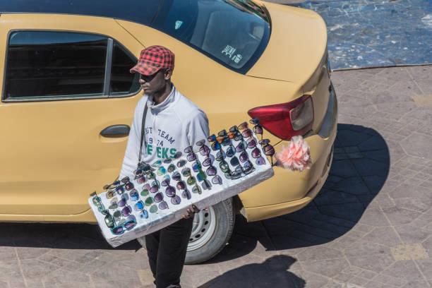 Street trader selling sunglasses in Jemaa el-Fnaa Square stock photo