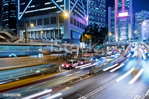 860696690 istock photo Street traffic in Hong Kong at night 1094550786