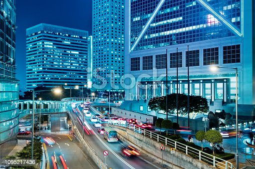 860696690 istock photo Street traffic in Hong Kong at night 1095217436