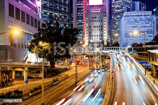 860696690 istock photo Street traffic in Hong Kong at night 1095318028