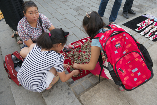 istock Street vendor in Houhai (Beijing) selling brass pendants 458279585