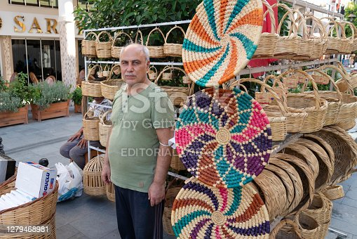 Hatay/Turkey- September 09 2020: Street vendor male selling straw objects.