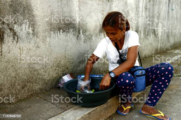 Street vendor peddling snack items rests on a sidewalk picture id1152846704?b=1&k=6&m=1152846704&s=612x612&h=kauhfoddmybe4g8omop34afuxgz4ov1wditgdhenk9q=