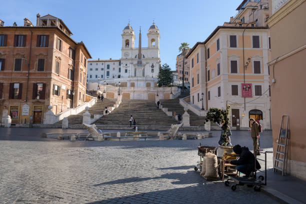 A street vendor prepares their stand in front of the deserted Spanish Steps stock photo