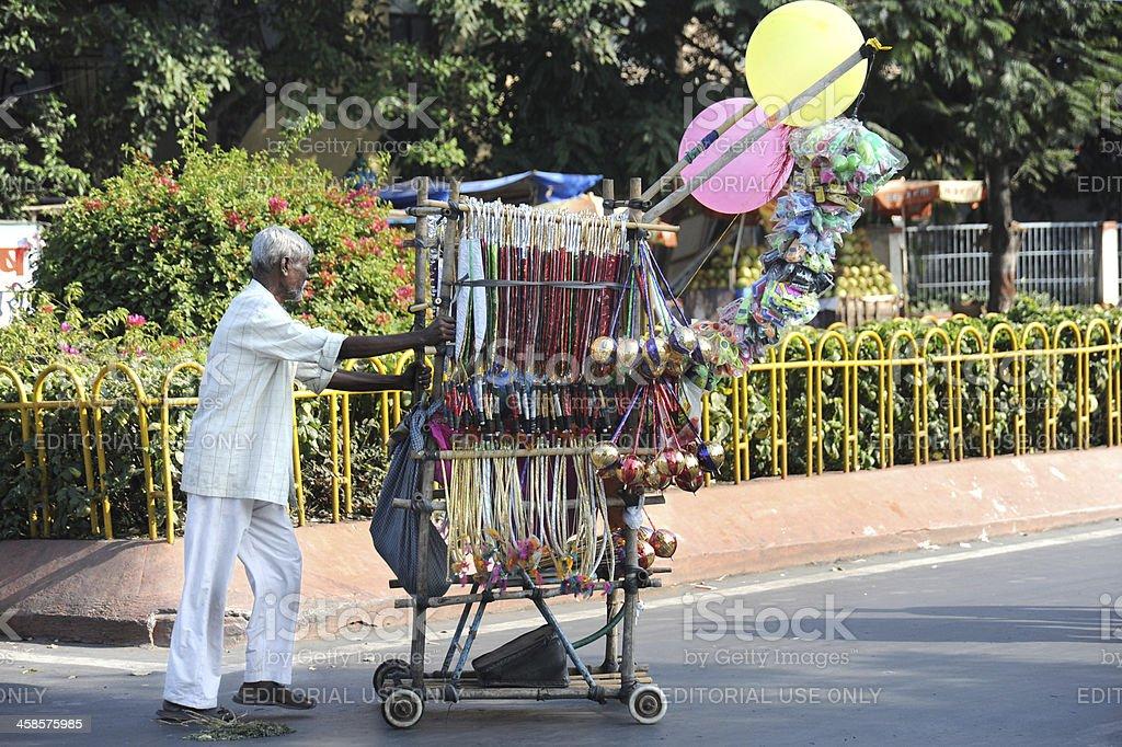 Street Vendor Pushing His Cart in India royalty-free stock photo