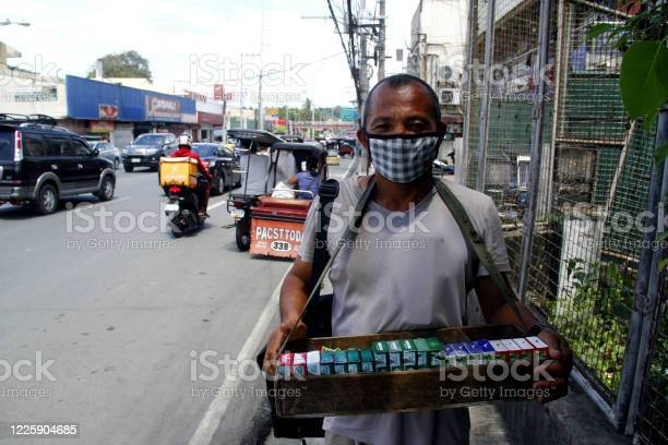 Street vendor sell cigarettes after quarantine rules were eased up picture id1225904685?b=1&k=6&m=1225904685&s=612x612&h=6f6yhfi55sqb8yv3pg5v3abi90y24o0xlipzyjxif e=