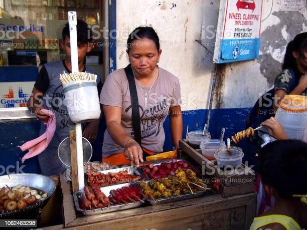 Street vendor sells assorted fried food on her food cart at a picture id1062463298?b=1&k=6&m=1062463298&s=612x612&h=k3nsapns2zgojfo22b2boczlyboa z3r8 e59m9gcj0=