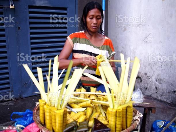 Street vendor sells suman or steamed glutenous rice wrapped in palm picture id1062464236?b=1&k=6&m=1062464236&s=612x612&h=0bqhgvhitnkcaj8mo94o ob8pzryiv nim59tanmdrw=