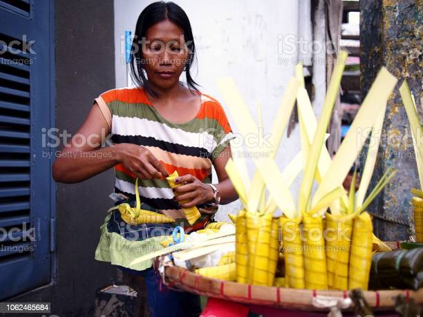 Street vendor sells suman or steamed glutenous rice wrapped in palm picture id1062465684?b=1&k=6&m=1062465684&s=612x612&h=cne tpsj nvop6pd9kjivos38skjlsfnedfovzrgrda=