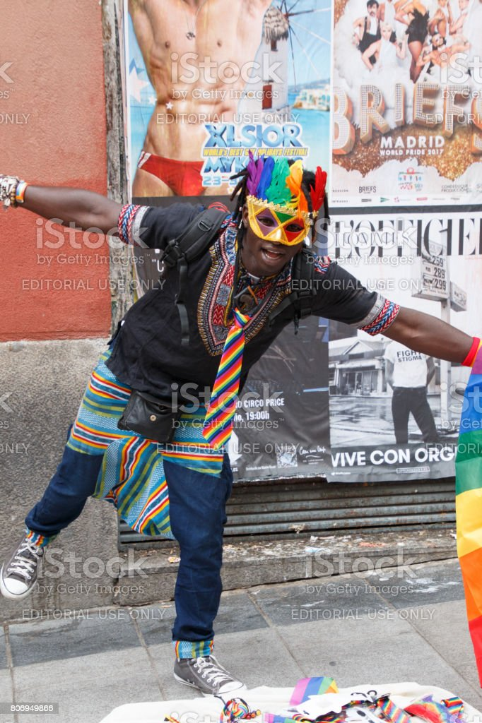 Street vendor taking advantage of the worldpride party in madrid stock photo