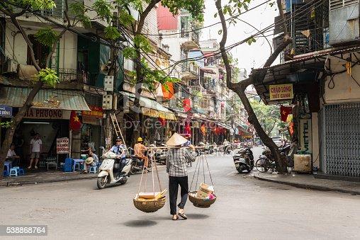 istock Street vendor transporting goods in baskets in Hanoi 538868764