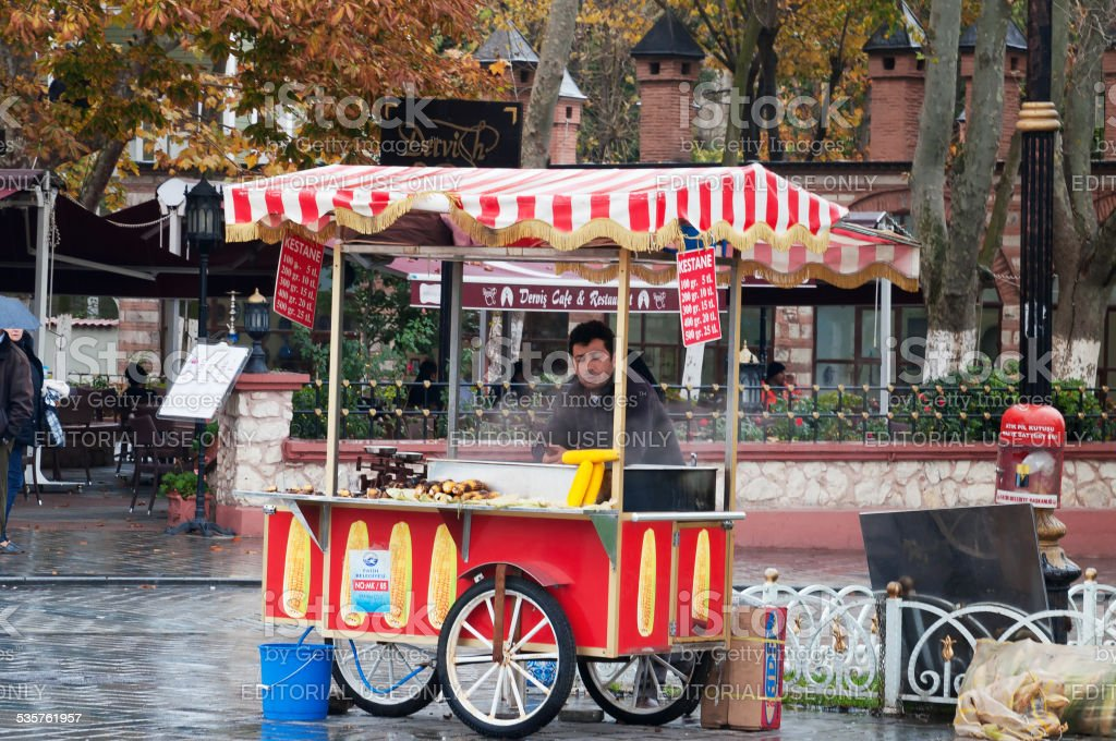 Street vendor with a colorful cart stock photo