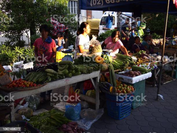 Street vendors sells assorted fruit and vegetable at a makeshift at picture id1062468072?b=1&k=6&m=1062468072&s=612x612&h=quehyflqbopnt3swf7mygpml2cqqv9ncfkfpo 0swdk=