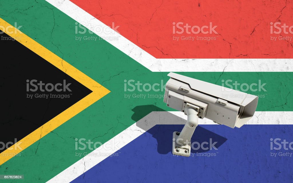 Street video CCTV surveillance on cracked wall with flag of South Africa stock photo