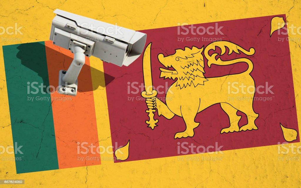 Street video CCTV surveillance on cracked wall with flag of Sri Lanka stock photo