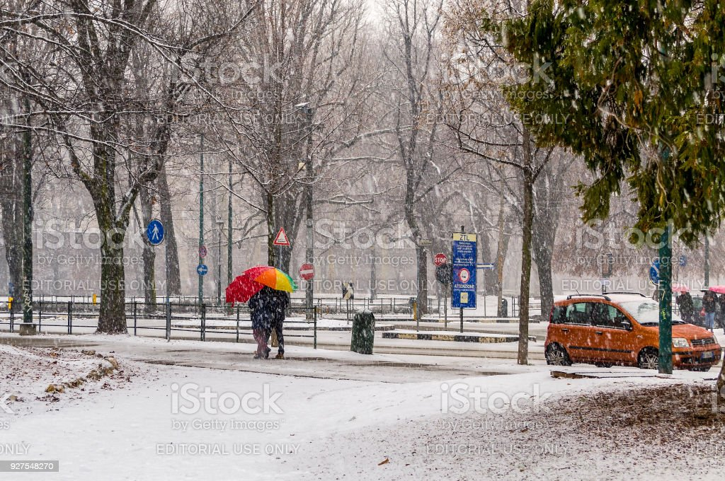 Street view during a snowfall at the Giardini Reali in Turin (Piedmont, Italy). stock photo