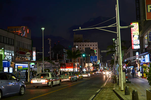 Street view from Naha, Okinawa Naha City, Okinawa, Japan - November 25, 2013: Night view from Kokusai dori, the main street in Naha City, Okinawa, Japan. The Japanese island Okinawa is one of Japan´s southernmost islands. The climate at Okinawa is subtropical and the beaches are considered among the world´s most beautiful. kokusai dori okinawa stock pictures, royalty-free photos & images